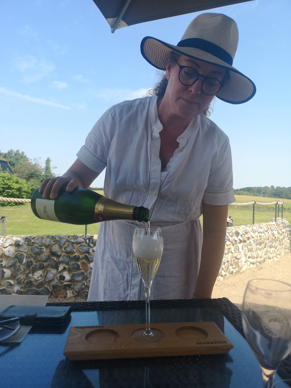 squerryes brut 2010 english sparkling wine being poured by their brand ambassador