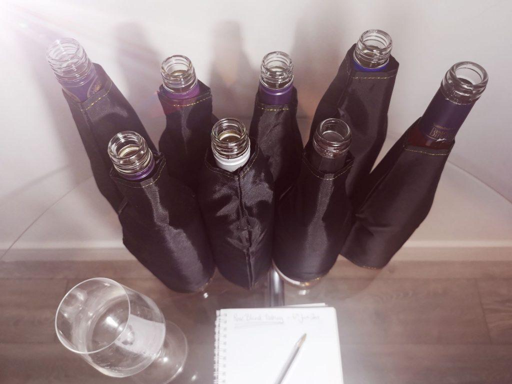 rose wine blind tasting - rose wine covered with black sleeve
