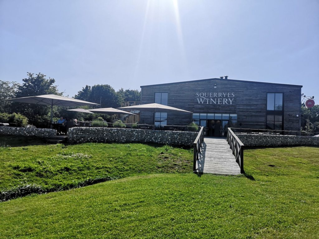 the outside of Squerryes Winery from terrace and vineyard