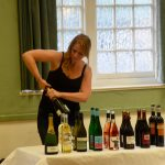 janina opening up the wines for the bromley wine society ( wine event in beckenham )
