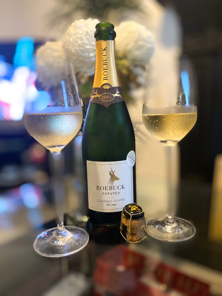 Bottle of Roebuck Estate English Sparkling wine with champagne glasses