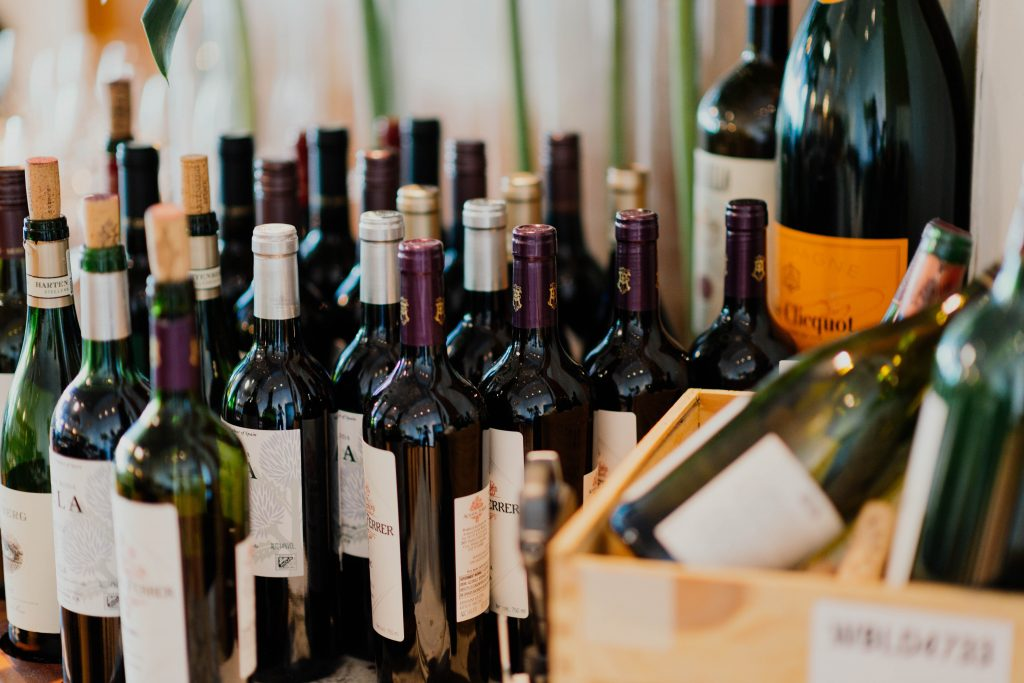 wine tasting - lots of opened wine bottles
